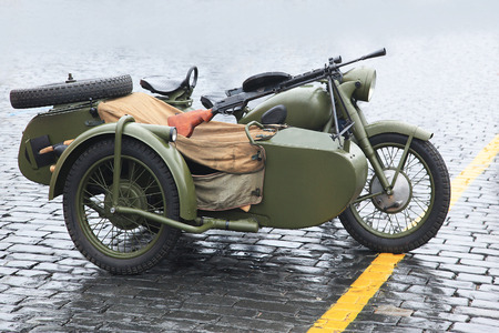 speed gun: Old Russian military motorcycle with a machine gun Stock Photo
