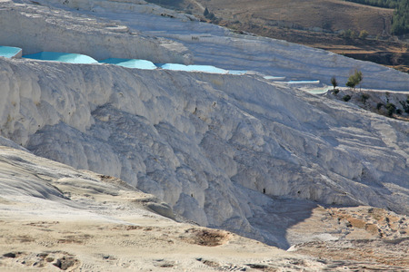 travertine: Natural travertine pools and terraces in Pamukkale, Turkey Stock Photo