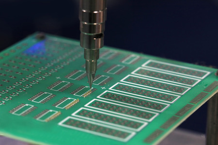 integrated circuits: robot solder PCB for integrated circuits Stock Photo