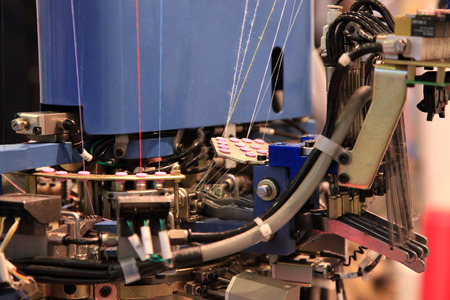 machine made: Machine for knitting socks at the textile factory