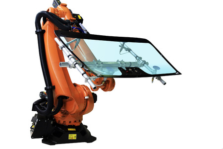 The industrial robot takes the car windshield on the Assembly. Isolated on white.