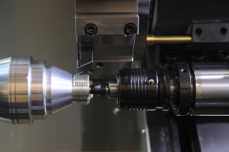 affixment: industrial metal work bore machining process by cutting tool on automated lathe