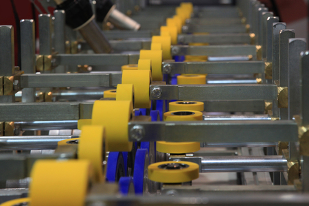 furniture: roller conveyor for furniture manufacture for forming furniture parts Stock Photo