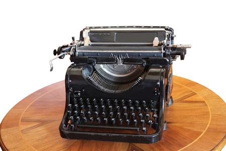 vintage document: vintage typewriter on a round wooden table