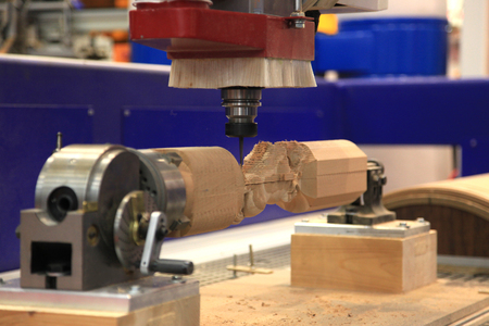 end mill: CNC machine for machining complex parts made of wood Stock Photo