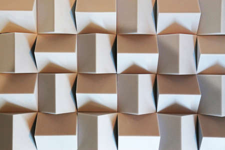 side lighting: Beige cubes with side lighting as the background Stock Photo