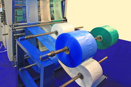 Cutting machine for polyethylene bags six lines Stock Photo