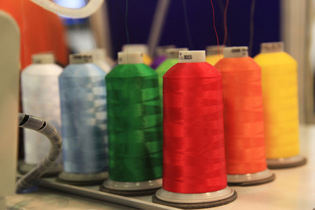 Spools of thread at a textile knitting machine