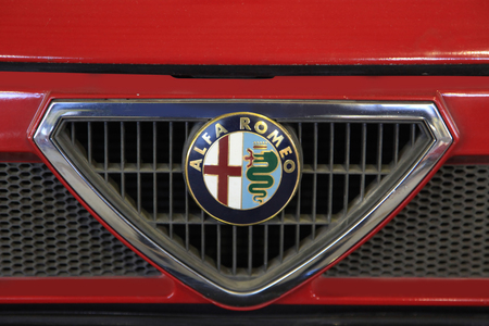 alfa: Logo ALFA ROMEO 75 1987 year - the exposure of the Moscow museum of retro cars - March 2016