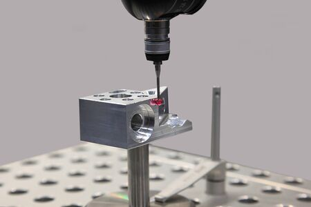 laser beam: Detail of the tip of a 3d laser scanner mechanical arm, with laser beam scanning a surface.