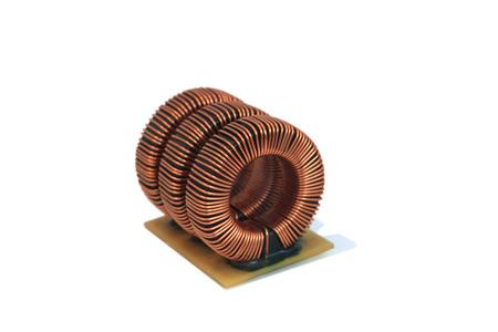 choke: Three industrial toroidal choke coil isolated  on white background Stock Photo