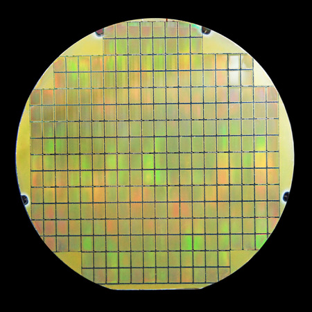 silicio: Silicon wafer with chips isolated on black background