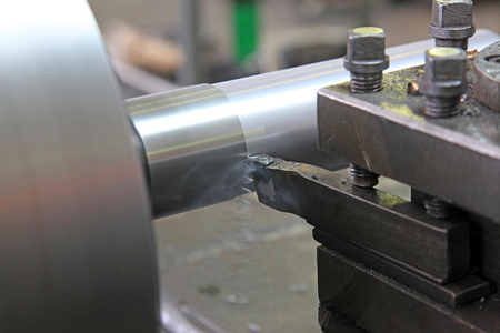 automated tooling: Processing of steel parts with a chisel on a lathe