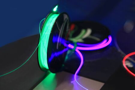 fiberoptic: Coil with fiber-optic wire to transmit information with light.