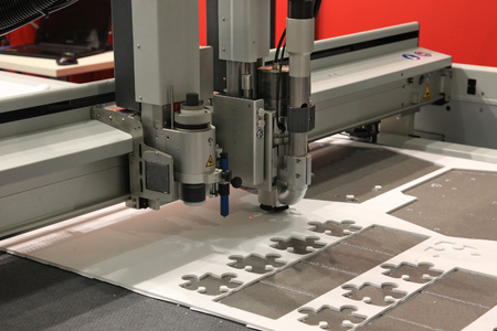 processing speed: High precision CNC sheet plastic stamping and punching machines Stock Photo