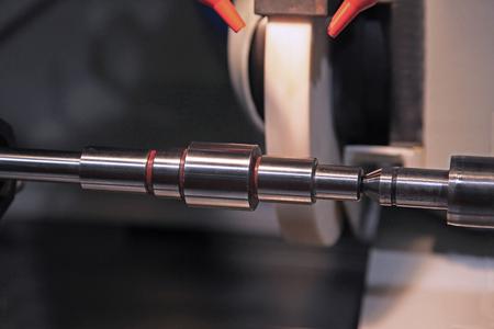 grinder machine: metalworking industry: finishing metal working on lathe grinder machine