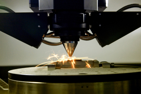 detail of 3d printer printing a metal piece Stock Photo