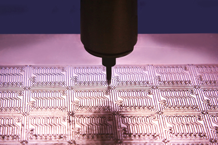 pcb: Drilling holes in the printed circuit board for mounting chips. Stock Photo