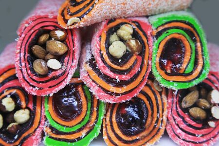 locum: Different colorful tasty Turkish sweet as background