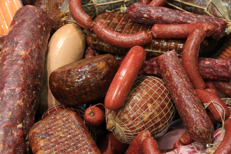 stale: lot of different sausages and salami closeup. stale sausages with mold
