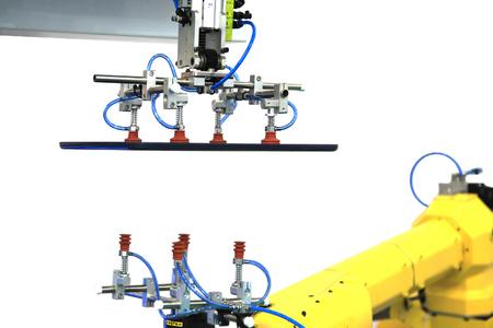 conveys: Industrial robot with vacuum suckers conveys the plastic part