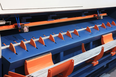 machine cutting reinforcing bars in the desired size