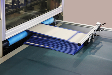 process in a modern printing house-gluing of covers Reklamní fotografie