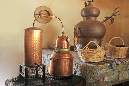 Alembic Copper. A distillation apparatus used for the production of alcohol, essential oils and moonshine. Фото со стока - 116840535
