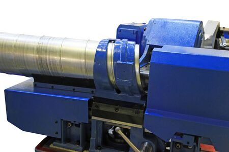 Machine for for manufacturing metal pipes and tubes in the factory. Stock Photo