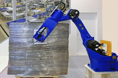 the robot marks the packaging of the goods Banco de Imagens