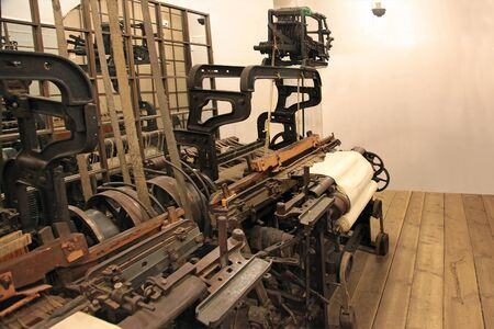 Old looms, arranged in the factory workshop Stock fotó