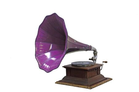 Old gramophone with plate and horn speaker on wooden box isolated on white background. Stockfoto