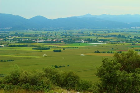 A photo of mountains and the fields beneath in greece Stock Photo