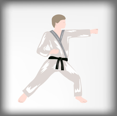 blow: The karate strikes blow, the athlete in a fighting rack, a black belt on judo, blow with a fist, the person punches, sports boxing
