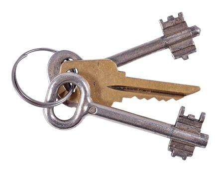 tarnished: Old keys on a white background