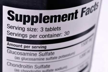 Closeup of a bottle of nutritional supplements Stock Photo