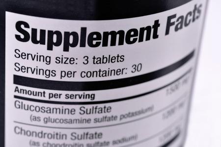 pastillas: Primer plano de una botella de suplementos nutricionales Foto de archivo