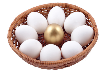 making money: Golden egg and jast eggs in wicker bowl on a white background