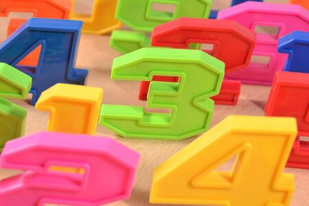 Colorful plastic numbers close up