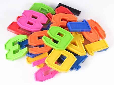numeracy: Colorful plastic numbers on a white background