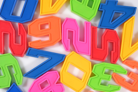 numeracy: Colorful plastic numbers close up on a white background Stock Photo