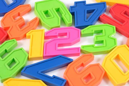 numeracy: Colorful plastic numbers 123 on white background