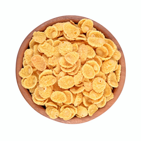 Cornflakes in a wooden bowl on a white background