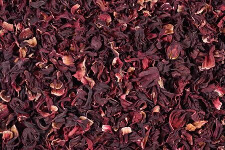Pile of dried petals of hibiscus as background texture Imagens
