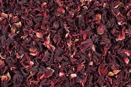 Stapel van droge bloemblaadjes van hibiscus als achtergrond textuur Stockfoto