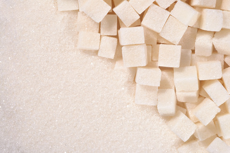 refined: White granulated and refined sugar as background texture