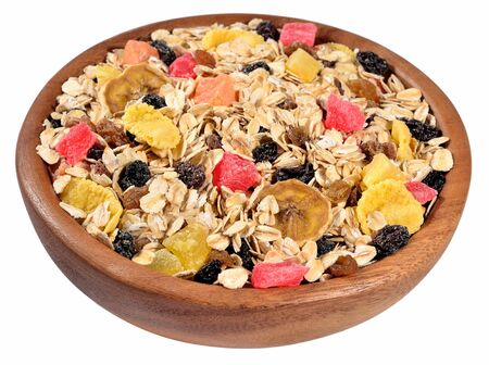 musli: Musli in a wooden bowl on a white background