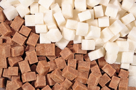 refined: Brown and white refined sugar as background