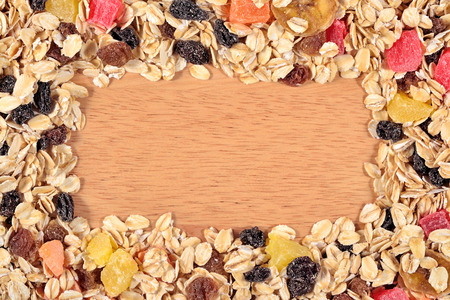 musli: Frame of musli on a wooden background
