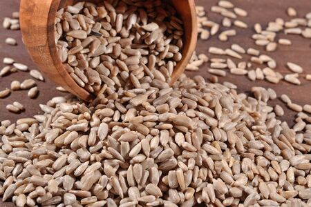 cleared: Cleared sunflower seeds in a wooden bowl Stock Photo